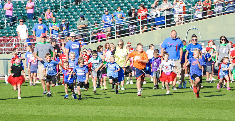 The Heart run continues their annual tradition of the kid's dash across the field. Towards the end of the event the kids line up across Werner Park to begin their run across the field. The dash is something that we have always done at our events Burton said. Its a moment celebrated by the kids to show how far they have come through their CHD journey.