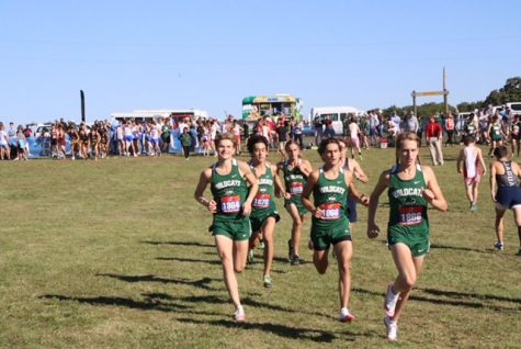 """The Millard West boys varsity team warms up for one of the toughest courses this season. Even with the tough competition they competed very well and aren't going to back down for the rest of the season. """"Going into the race I knew I could get a good time as long as I worked the uphills,"""" senior Cole Haith said. """"I have started to get more relaxed and more confident during the races."""""""