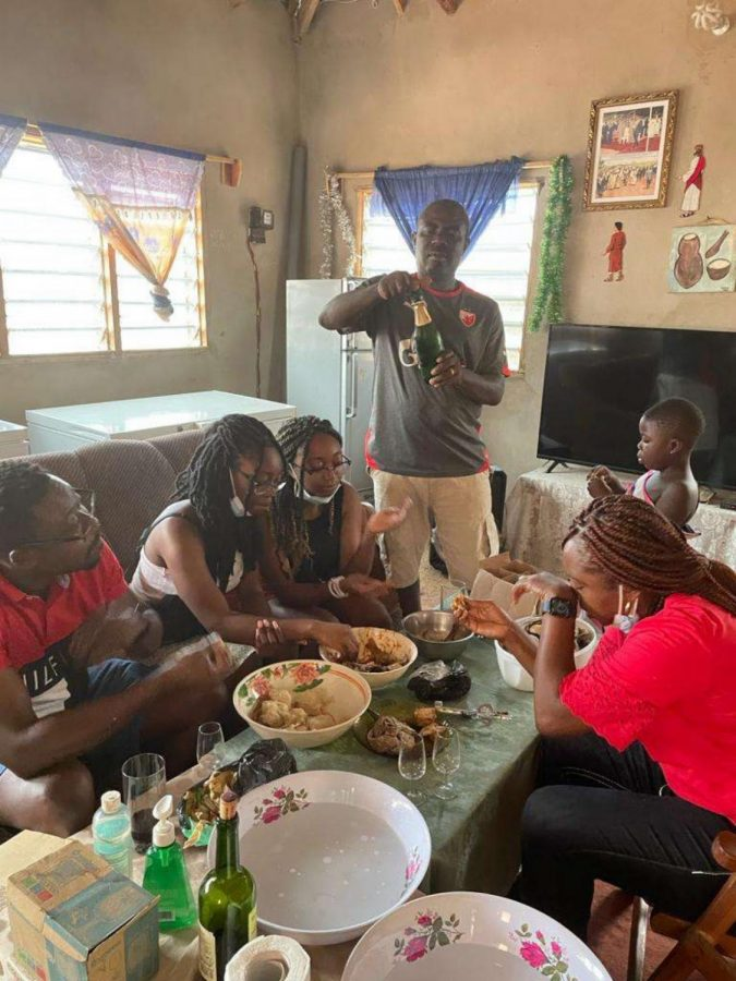 """Gathering among her relatives, senior Lauraine Komla-Ebri shares an African dish called Fufu, which is native to her home country, Lomé. After an absence lasting over 10 years, Komla-Ebri revisits her childhood home with numerous family members who traveled from Italy and France.""""This trip made me happy in many different ways,"""" Koma-Ebri said. """"Getting to see family I haven't seen in years and revisiting where I used to live and go to school was like a distant happy memory."""""""