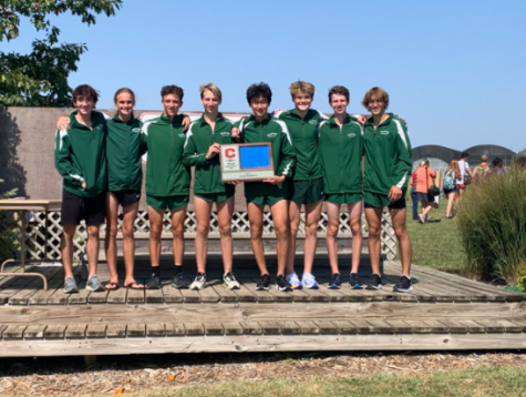 """The Millard West boys varsity team poses for pictures after bringing home first place in the meet. Each runner competed very well and all seven of them finished inside of the top 35. """"We were very very happy with the win,"""" Fey said. """"We beat regionally ranked teams that we had no clue about how good they were until the gun went off. We also know that we're looking good to win the state championship and maybe finish top two team wise at Nike Cross Regionals to be the first Nebraska team to ever make Nike Cross Nationals."""""""