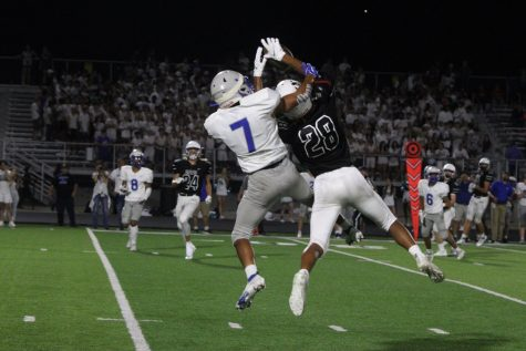 """Sophomore wide receiver Jackson Williams goes up for a tough catch against the Mustangs. The Wildcats would go on to win the game 56-31. """"We really used the momentum of the crowd to get us going,"""" Williams said. """"They"""