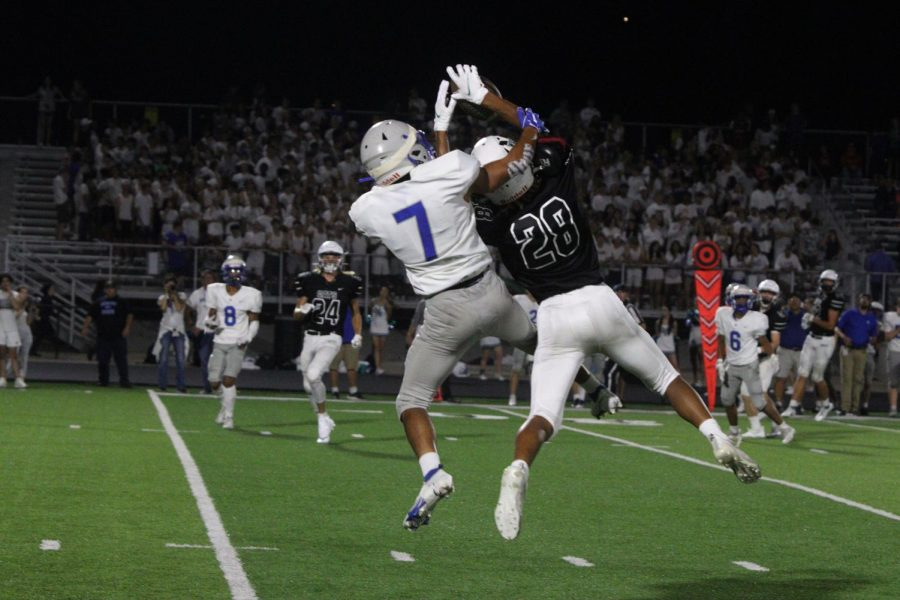 Sophomore wide receiver Jackson Williams goes up for a tough catch against the Mustangs. The Wildcats would go on to win the game 56-31.