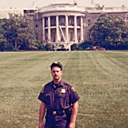 """Pictured outside the White House, Secret Service Special Agent Steve Haw poses for a picture. Steve was in the secret service for 12 years and worked in the uniformed division. """"I loved working at the White House,"""" Haw said. """"I got to meet a lot of interesting people and travel a lot."""""""