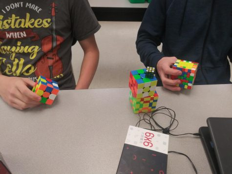 An assortment of completed Rubiks Cubes. Rubiks Cubes are the main focus of the club, but they are all different sizes, such as the standard 3x3 or the more advanced 7x7.