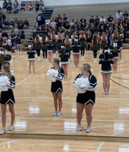"""The Millard West cheerleaders perform at the entrance of the pep rally. The girls have been working hard all season at games perfecting their skills. """"Performing at the pep rallies gets everyone pumped up and energized"""", sophomore Ayda Matya said."""
