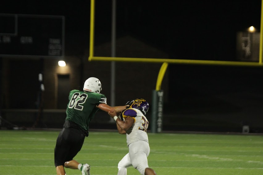 Senior tight end Trace Thaden laying the hammer on a monster stiff arm for a huge gain.