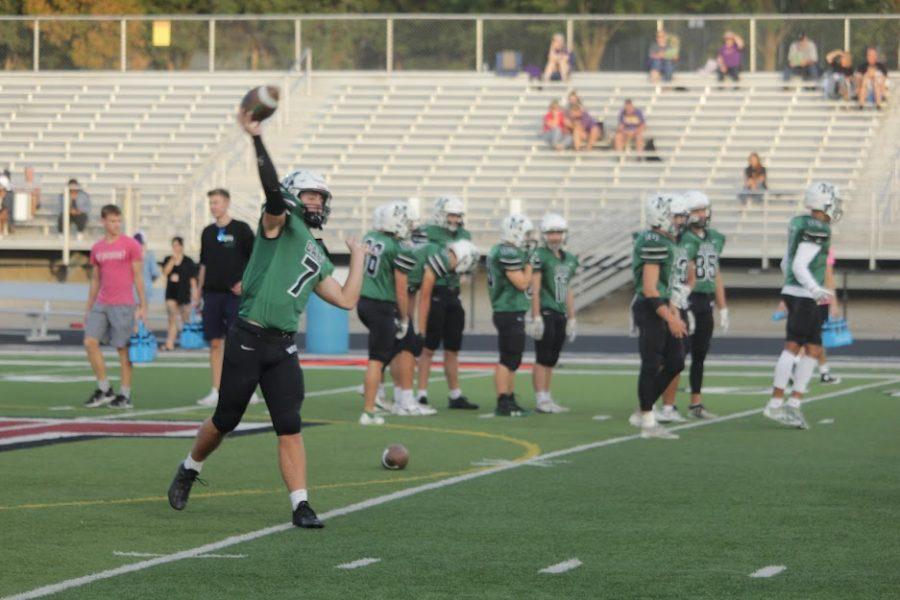Sophomore+quarterback+Brody+Peterson+warming+up+pregame.