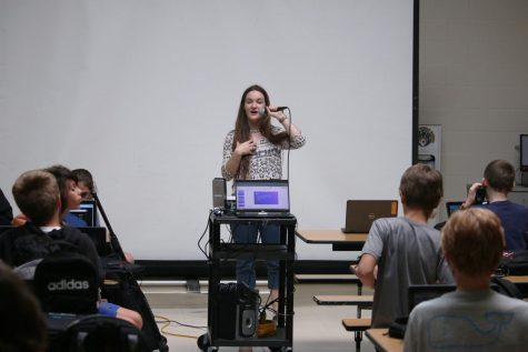"""Explaining to the Russell Middle school students about computer science, senior Cecilia Beckerbauer starts her meeting with a quick attention grabber. This is the second meeting of an eight meeting series. At the first meeting Beckerbauer discussed they will be going over the seven principles of computer science each week. """"We plan on exposing them to software, hardware, cyber security, IT innovation, engineering, AI and CS design,"""" Beckerbauer said. """"Each meeting consists of a fun beginning activity in which they take a subject of their choosing and use CS to create a game or resources for said topic. Then there is a demonstration put on by our wonderful CS Club members and myself."""""""